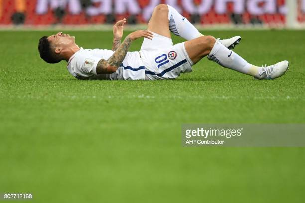 Chile's midfielder Pablo Hernandez reacts as he lies on the pitch during the 2017 Confederations Cup semifinal football match between Portugal and...