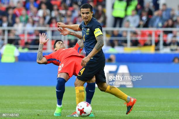 Chile's midfielder Pablo Hernandez vies for the ball against Australia's forward Tim Cahill during the 2017 Confederations Cup group B football match...