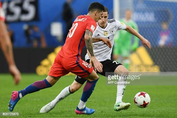 Chile's midfielder Pablo Hernandez vies for the ball against Germany's midfielder Sebastian Rudy during the 2017 Confederations Cup final football...