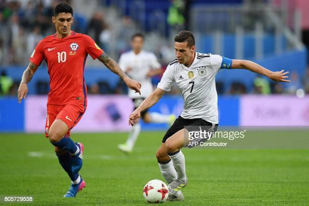Chile's midfielder Pablo Hernandez vies for the ball against Germany's midfielder Julian Draxler during the 2017 Confederations Cup final football...