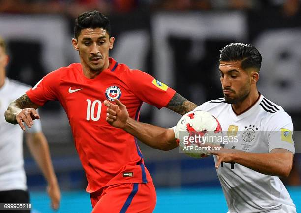 Chile's midfielder Pablo Hernandez vies with Germany's midfielder Emre Can during the 2017 Confederations Cup group B football match between Germany...