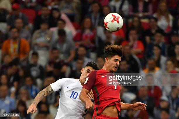 Chile's midfielder Pablo Hernandez vies with Portugal's forward Andre Silva during the 2017 Confederations Cup semifinal football match between...