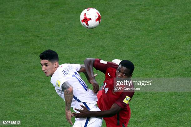 Chile's midfielder Pablo Hernandez vies with Portugal's midfielder William during the 2017 Confederations Cup semifinal football match between...