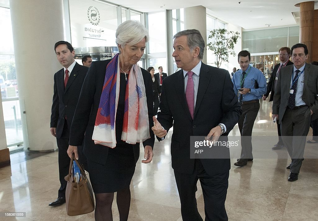 Chile's Minister of Finance Felipe Larrain (R) and International Monetary Fund (IMF) Managing Director Christine Lagarde (L) are seen upon arrival at the opening of the Community of Latin American and Caribbean States (CELAC) summit on December 14, 2012 in Vina del Mar, Chile. AFP PHOTO / Claudio SANTANA