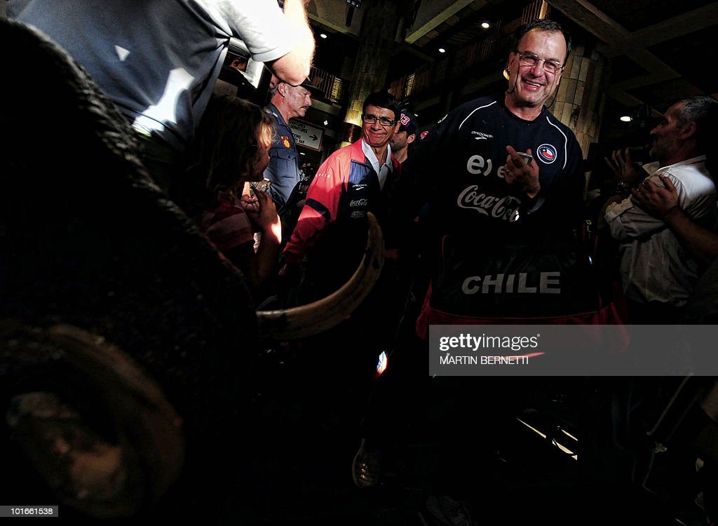 Chile's national football coach Marcelo Bielsa (R) arrives with the team at the airport in Nelspruit on June 6, 2010 for preparations ahead of the 2010 World Cup football tournament. Chile will play against Honduras in their first World Cup match on June 16. AFP PHOTO / Martin BERNETTI