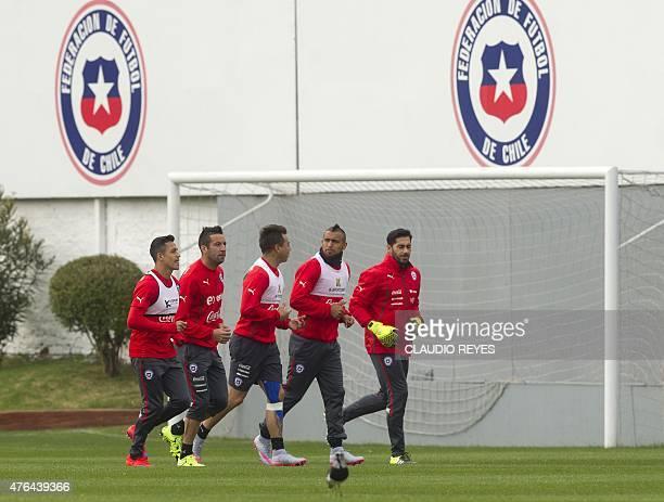 Chile's national football team players Alexis Sanchez Mauricio Isla Eduardo Vargas Arturo Vidal and Johnny Herrera jog during a training session in...