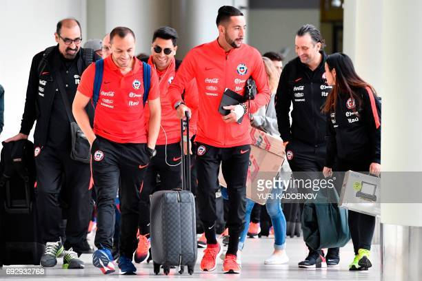 Chile's national football team players Marcelo Diaz and Mauricio Isla arrive at Sheremetyevo International Airport in Moscow on June 6 to take part...