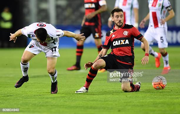 Chile´s Palestino Esteban Carvajal vies for the ball with Brazil´s Flamengo footballer Mancuello during their Copa Sudamericana football match on...