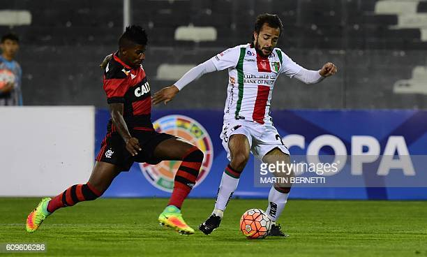 Chile´s Palestino footballer Mathias Vidangossy vies for the ball with Brazil´s Flamengo footballer Rodinei during their Copa Sudamericana football...