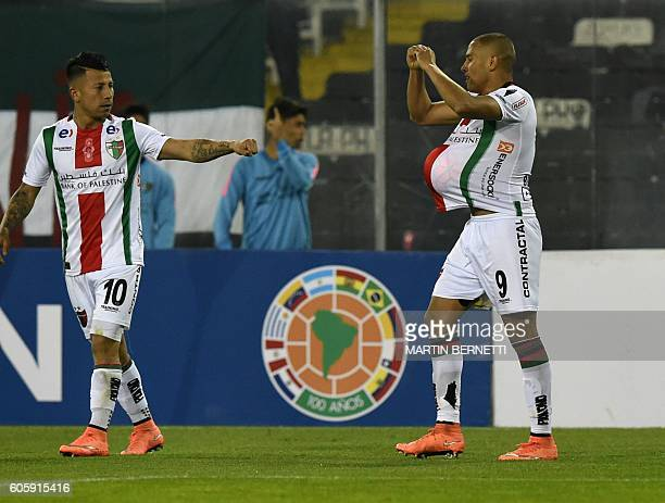 Chile´s Palestino player Leandro Benegas celebrates with Leonardo Valencia a goal against Peru´s Real Garcilaso during their Copa Sudamericana...