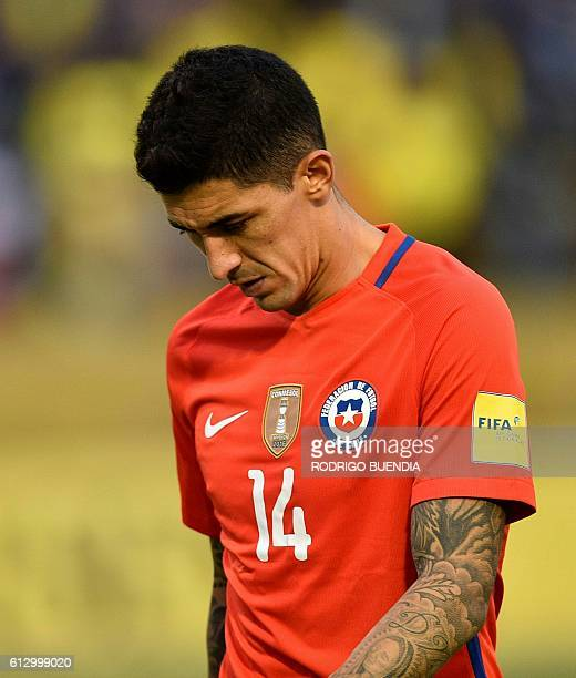 Chile's Pedro Pablo Hernandez leaves the field in dejection after losing to Ecuador in a Russia 2018 World Cup football qualifier match in Quito on...