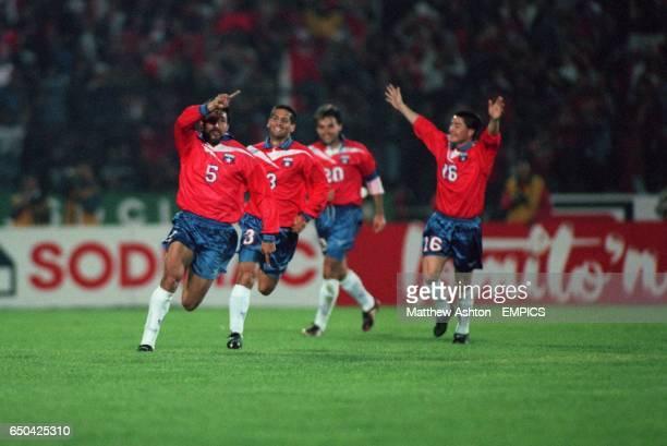 Chile's Pedro Reyes celebrates his goal with teammates Ronald Fuentes Fernand Cornejo Jimenez and Jose Luiz Sierra Pando