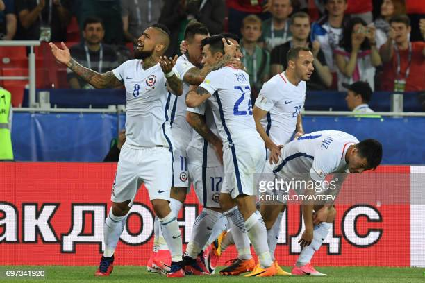TOPSHOT Chile's players celebrate a goal that was ruled offside by video assistant referees during the 2017 Confederations Cup group B football match...