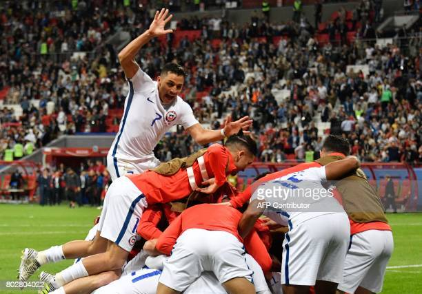 TOPSHOT Chile's players celebrate after Chile won the 2017 Confederations Cup semifinal football match between Portugal and Chile at the Kazan Arena...