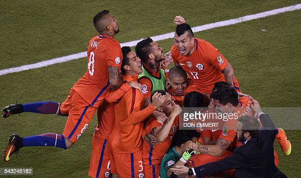 Chile's players celebrate after defeating Argentina in the penalty shootout and winning the Copa America Centenario final in East Rutherford New...