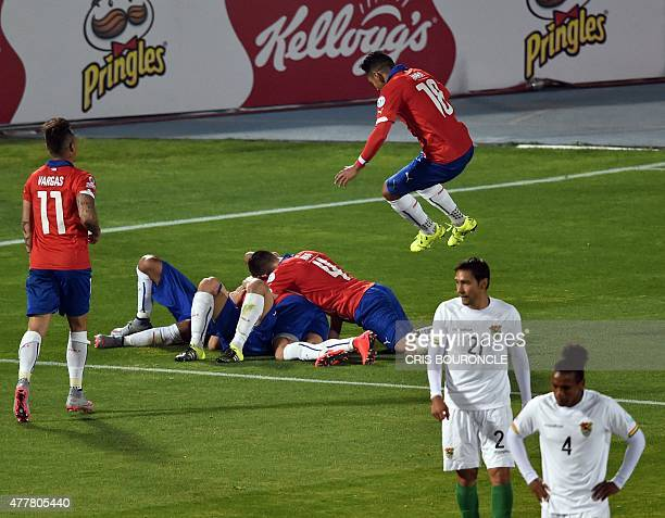 Chile's players celebrate after teammate Alexis Sanchez scored against Bolivia during their 2015 Copa America football championship match in Santiago...