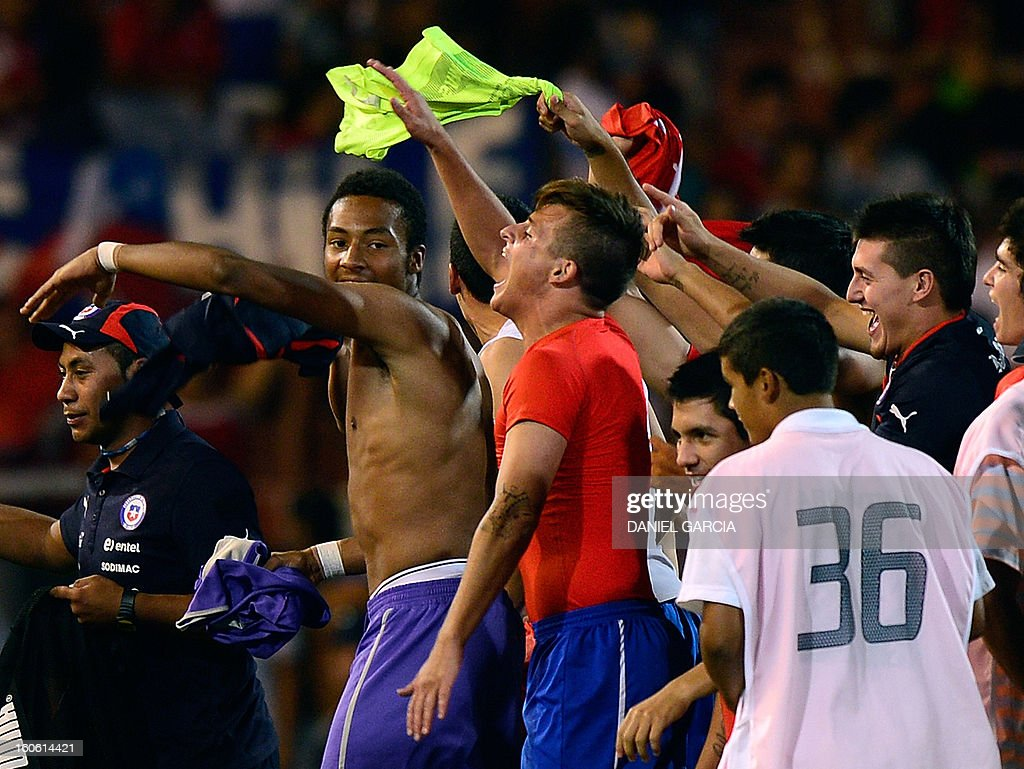 Chile's players celebrate at the end of their South American U-20 final round football match against Peru at Malvinas Argentinas stadium in Mendoza, Argentina, on February 3, 2013. Four teams will qualify for the FIFA U-20 World Cup Turkey 2013.
