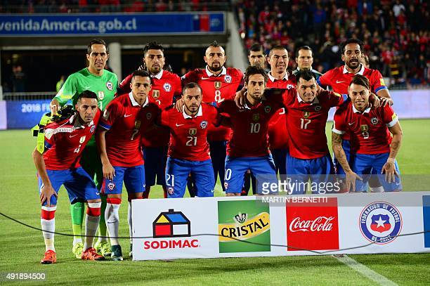 Chile's players pose for pictures before the start of their Russia 2018 FIFA World Cup South American qualifier match against Brazil in Santiago on...