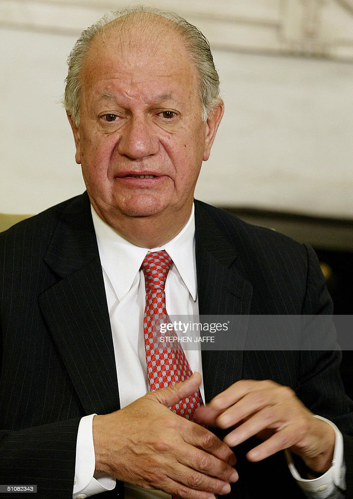Chile's President Ricardo Lagos speaks to the media during a meeting with US President George W. Bush (not shown) in the Oval Office of the White House 19 July 2004 in Washington, DC. Bush and Lago were to discuss democracy and trade in Latin American, notably on the free trade agreement between the two countries that took effect 01 January. Since the deal, Chile's exports to the United States have jumped by 13 percent, while US exports to Chile rose 13 percent. AFP Photo/Stephen JAFFE