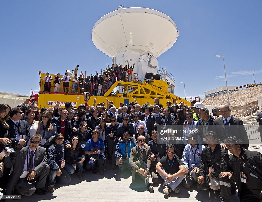 Chile's President Sebastian Pinera (C) and General Director ESO, Tim De Zeeuw pose with worker after the inauguration of the ALMA Observatory (Atacama Large Millimeter/submillimeter Array) in the San Pedro de Atacama , some 1500 km north of Santiago, on March,13,2013. The ALMA, an international partnership project of Europe, North America and East Asia with the cooperation of Chile, is presently the largest astronomical project in the world. Today will be opened 59 of 66 high precision antennas, located at 5000 of altitude in the extremely arid Atacama desert. AFP PHOTO/Martin BERNETTI