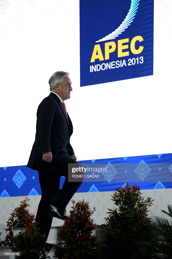 Chile's President Sebastian Pinera arrives to deliver his address at the Asia Pacific Economic Cooperation CEO summit attended by leaders of APEC member countries and top international business executives in Nusa Dua on the Indonesian resort island of Bali on October 6, 2013. The APEC summit will take place from October 7 to 8 with 21 world leaders participating in the event.