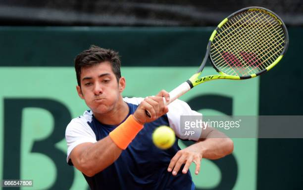 Chile's tennis player Christian Garin returns the ball to Colombia's Santiago Giraldo during their Davis Cup match in Medellin Colombia on April 9...