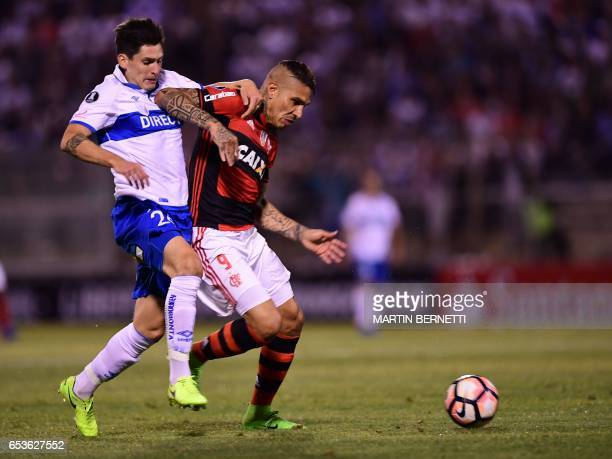 Chile's Universidad Catolica Alfonso Parot vies for the ball with Brazil's Flamengo Paolo Guerrero during their Libertadores Cup football match at...