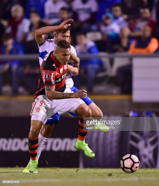 Chile's Universidad Catolica German Lanaro vies for the ball with Brazil's Flamengo Paolo Guerrero during their Libertadores Cup football match at...