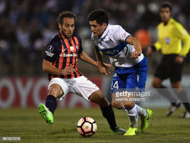 Chile´s Universidad Catolica player Alfonso Parot vies for the ball with Argentina´s San Lorenzo footballer Rodrigo de Ciancino during their Copa...
