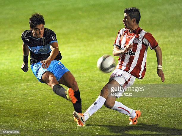 Chile's Universidad Catolica player Stefano Magnasco vies for the ball with Uruguay's River Plate player Michael Santos during their Copa...