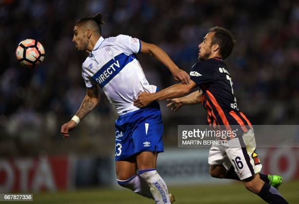 Chile´s Universidad Enzo Kalinski vies for the ball with Argentina´s San Lorenzo footballer Fernando Bellushi during their Copa Libertadores football...