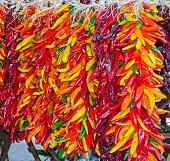 Multicolored chili pepper ristras hang together in Hatch, New Mexico.