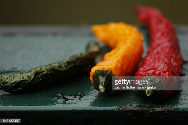 Chili Peppers On Wet Table