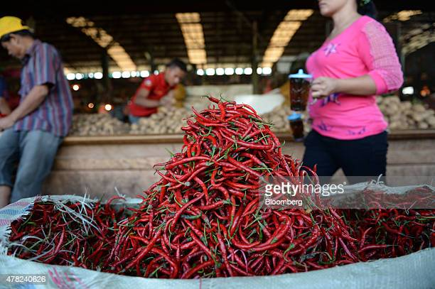 Chili peppers sit at a stall at the Pasar Induk Kramat Jati market in Jakarta Indonesia on Sunday June 21 2015 Food inflation the rupiah's...