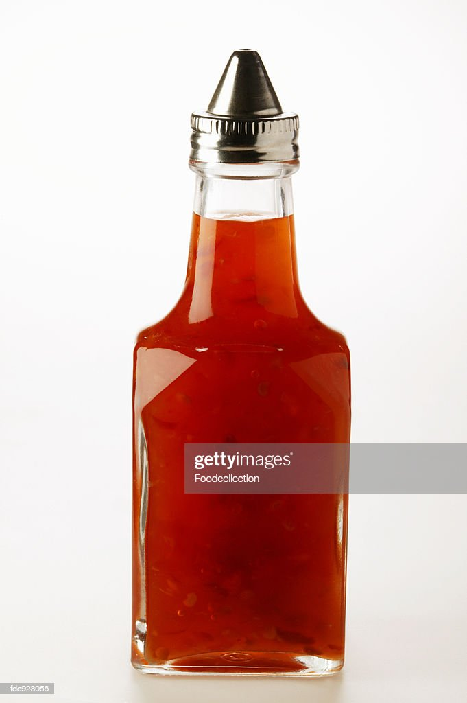 Chili sauce in small bottle : Stock Photo