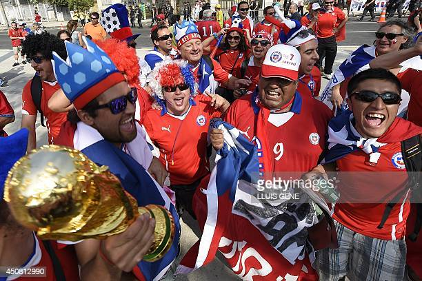 Chilian supporters cheer outside the Maracana Stadium before a Group B football match between Spain and Chile in Rio de Janeiro during the 2014 FIFA...