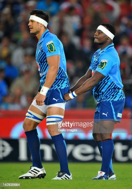 Chiliboy Ralepelle of the Bulls holds on to the shorts of teammate Pierre Spies during the 2012 Super Rugby match between MTN Lions and Vodacom Bulls...