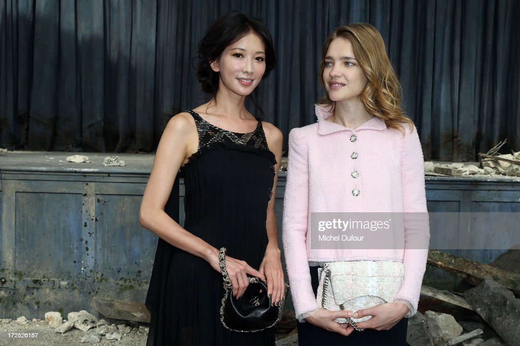 Chi-ling Lin and Natalia Vodianova attend the Chanel show as part of Paris Fashion Week Haute-Couture Fall/Winter 2013-2014 at Grand Palais on July 2, 2013 in Paris, France.