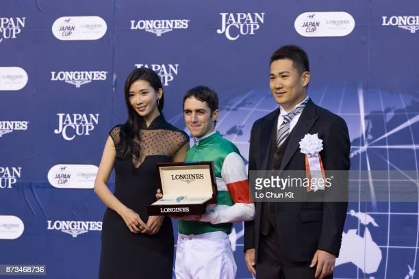 Chiling Lin Christophe Soumillon and Tanaka Masahiro at the Japan Cup presentation ceremony at Tokyo Racecourse on November 30 2014