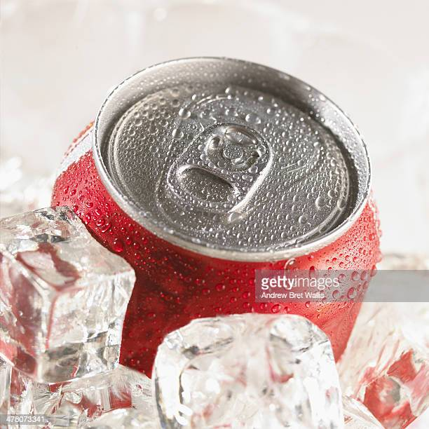 Chilled cola can on a bed of ice