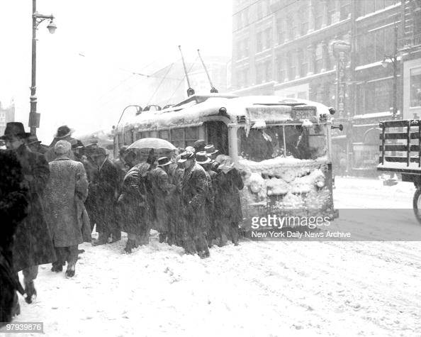 Chilled commuters try to crowd aboard stuffed bus at Broad and Market Streets in Newark New Jersey Buses were few and far between