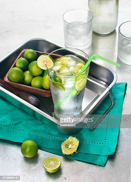 Chilled lime juice with ice cube in glasses.
