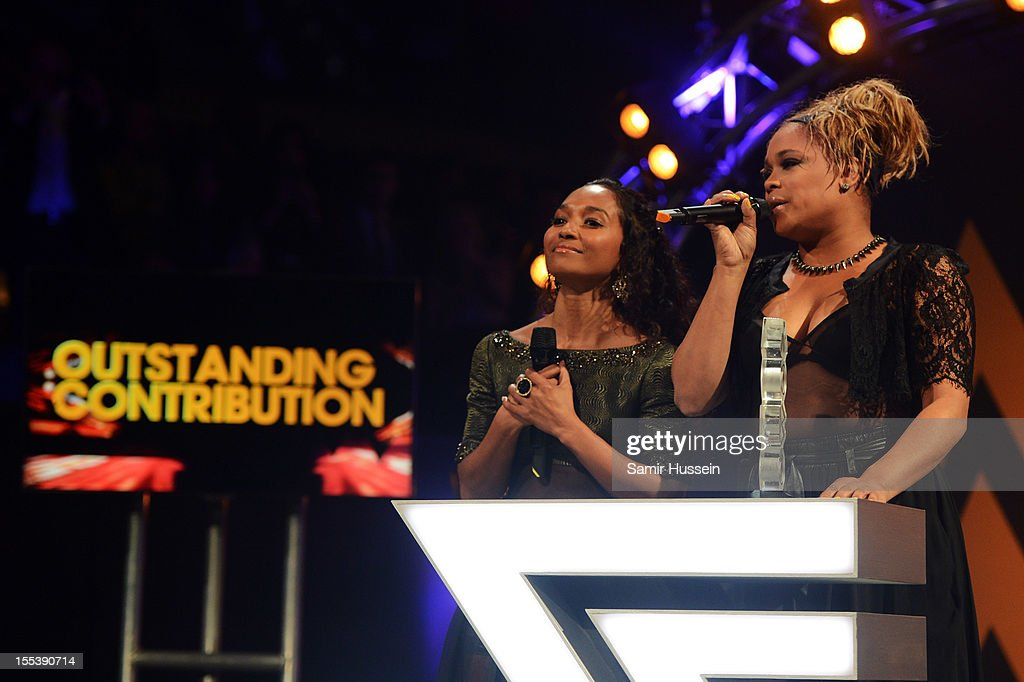 Chilli and <a gi-track='captionPersonalityLinkClicked' href=/galleries/search?phrase=T-Boz&family=editorial&specificpeople=715877 ng-click='$event.stopPropagation()'>T-Boz</a> of TLC accept the award for Outstanding Contribution to Music at the 2012 MOBO awards at Echo Arena on November 3, 2012 in Liverpool, England.