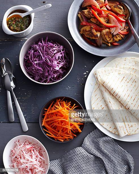 Chilli chicken fajitas with fresh raw vegetables