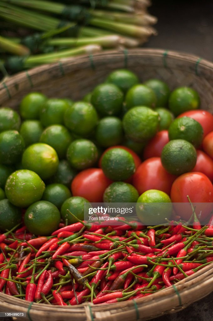 Chillies, limes and tomatoes in Hoi An Market : Stock Photo