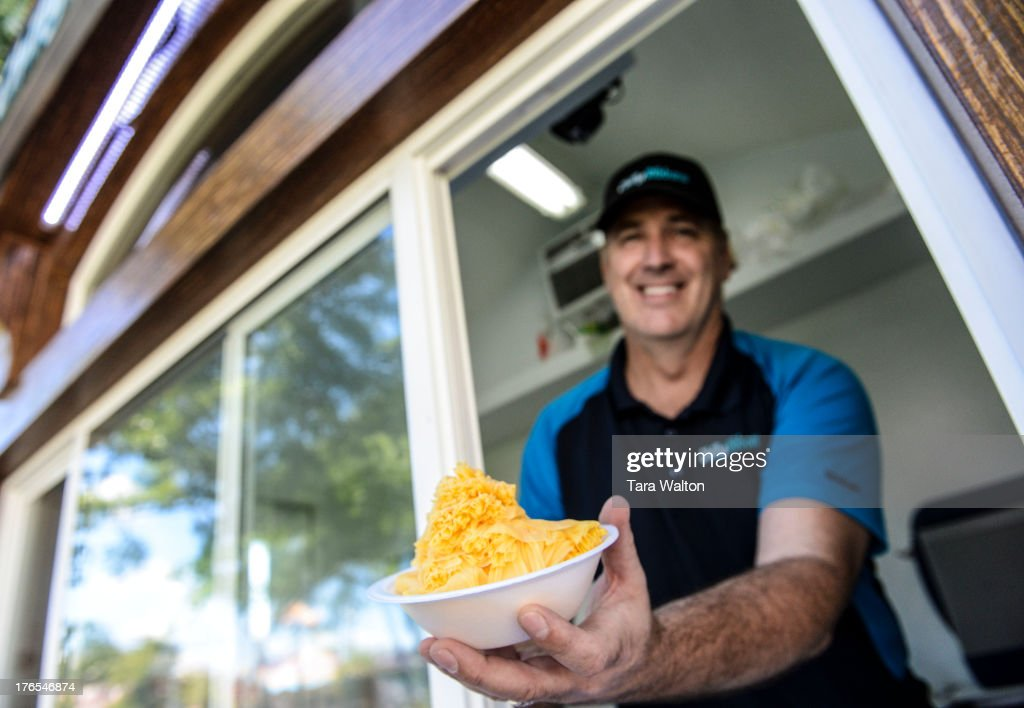 TORONTO ON Chilly Ribbons owner Scott Colwell holds his mango shaved iced dessert from his CNE stand Wednesday August 14 2013 Chilly Ribbons makes a...