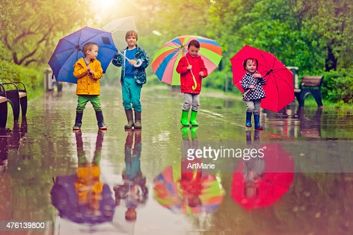 Chilren under umbrella