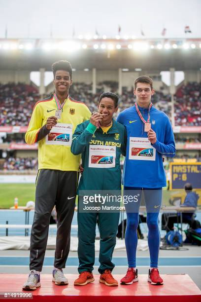 Chima Ihenetu of Germany Breyton Poole of South Africa and Vladyslav Loveskyy of Ukraine pose during medal ceremony of the boys high jump final...