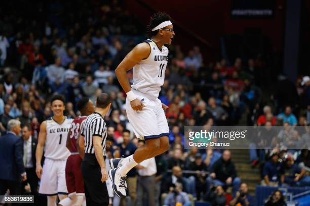 Chima Moneke of the UC Davis Aggies celebrates defeating the North Carolina Central Eagles 6763 during the First Four game in the 2017 NCAA Men's...