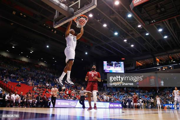 Chima Moneke of the UC Davis Aggies dunks the ball in the first half against the North Carolina Central Eagles during the First Four game in the 2017...
